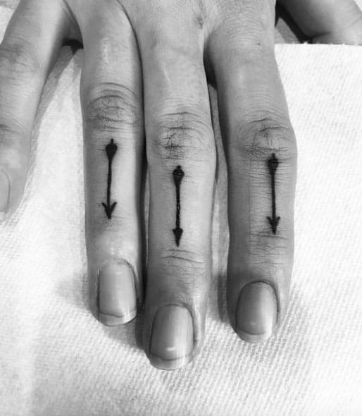 Arrow Tattoos on Finger by Kc Cooper