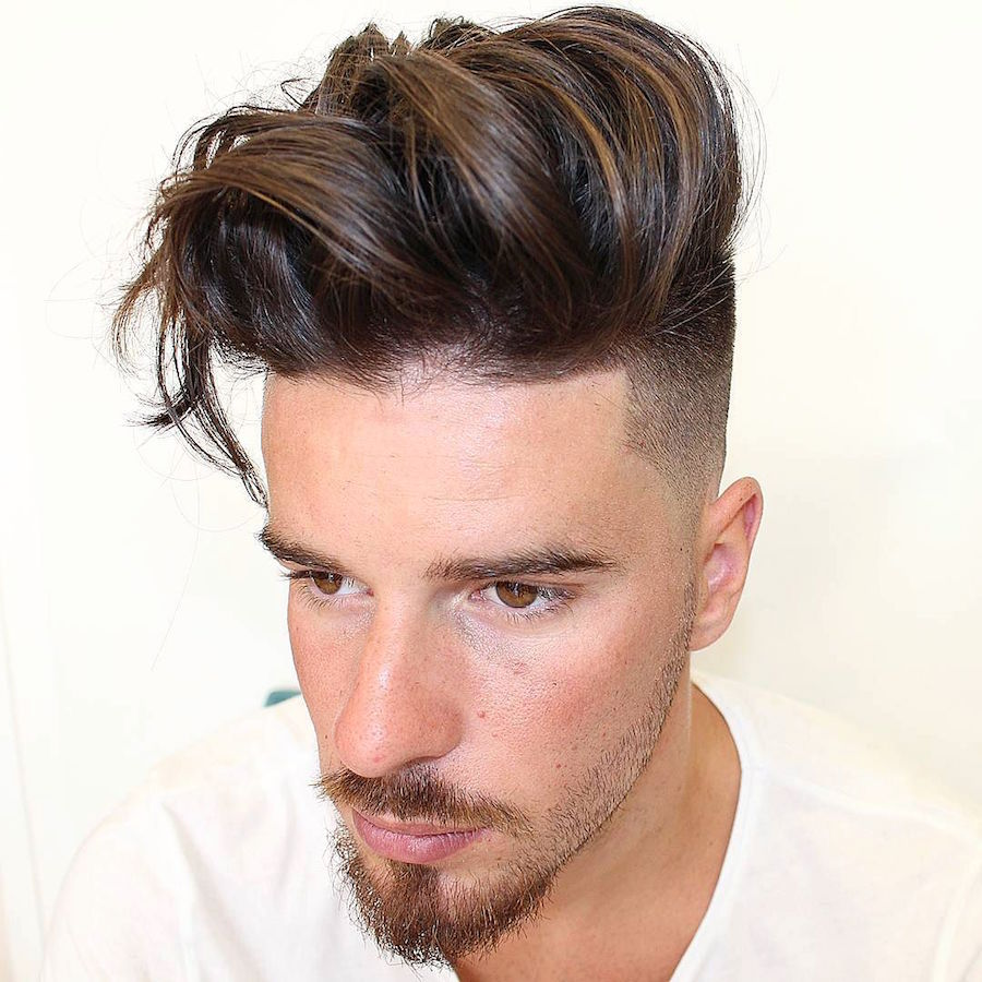 High fade with long thick hair and long fringe