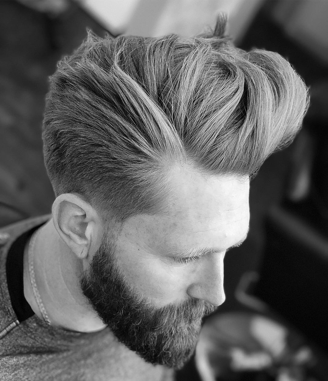 Cool long pompadour hairstyle for men with shaved sides