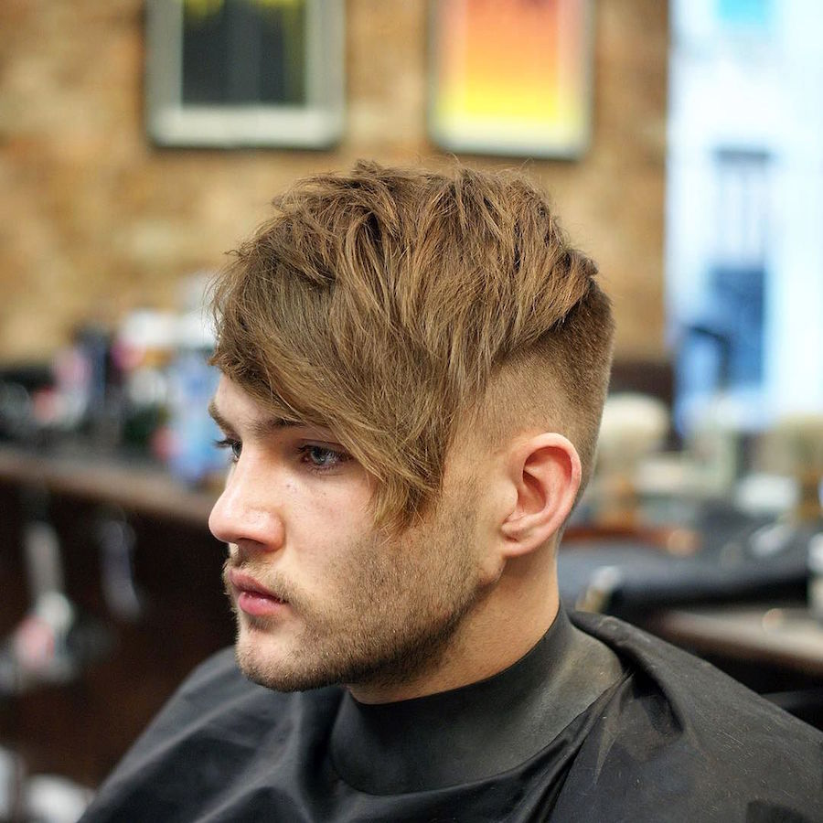 Textured crop with long fringe and undercut hairstyle for men
